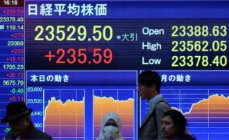 日経平均株価は12月に年初来高値を更新(AFP/時事)